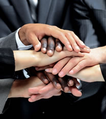 Photo of business people putting their hands together as a team..