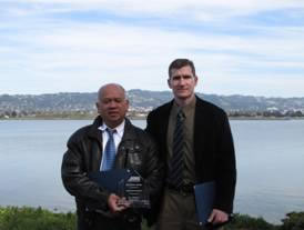 Photo shows project engineers Marvin Montoya and Paul Modrell receiving award.